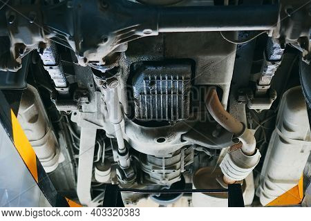 Bottom View Of The Car Bottom. Diagnostics And Repair Of A Vehicle In An Auto Repair Shop. Detailed