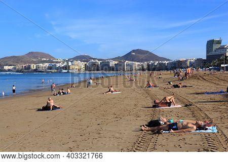 Las Palmas, Spain - November 30, 2015: People Visit Las Canteras Beach In Las Palmas, Gran Canaria,