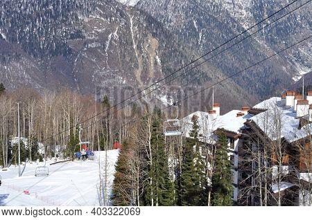 Rosa Khutor, Russia - December 15, 2017: Ski Resort Rosa Khutor, Sochi. Chair Lift With Mountains In
