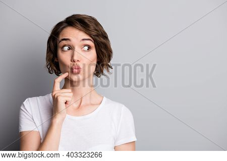 Portrait Of Young Beautiful Curious Woman Girl Female Look In Copyspace Pout Lips Isolated On Grey C