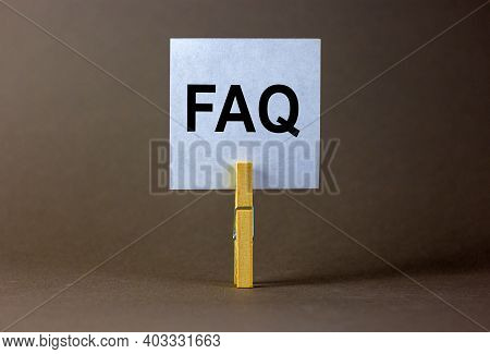 Faq, Frequently Asked Questions Symbol. White Paper On Wooden Clothespin. Words 'faq, Frequently Ask