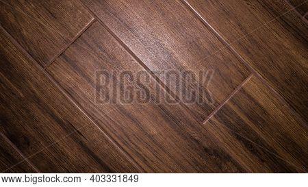 Matt Tiles, Walnut-like Floor Tiles, Wood Texture. The Floor Is Covered With Tiles.