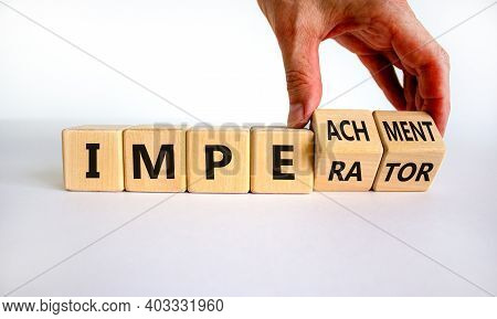 Imperator Or Impeachment Symbol. Businessman Hand Turns Wooden Cubes And Changes The Word 'imperator