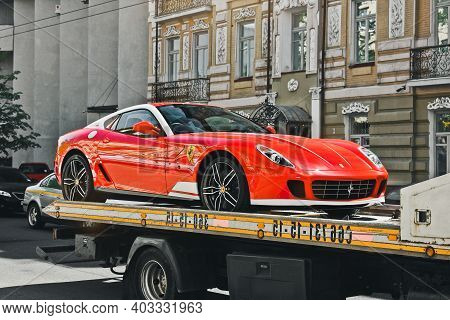 Kiev, Ukraine - May 12, 2012: Red Supercar Ferrari 599 Alonso Edition 60f1 In The City. Car On A Tow