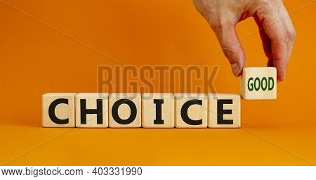 Good Choice Symbol. Wooden Cubes With Words 'good Choice'. Businessman Hand. Beautiful Orange Backgr