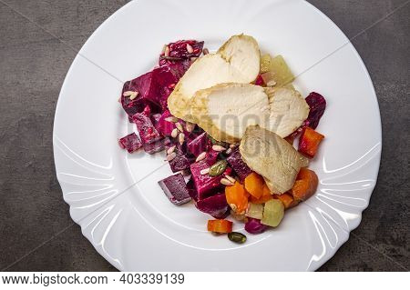 Chicken Breast With Salad Of Roasted Beets, Radishes, Carrots And Celery With Seeds. Healthy Dinner