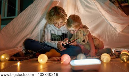 Two Adorable Little Siblings, Brother And Sister Using Digital Tablet While Spending Time Together,