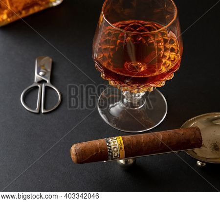 Cuban Cigar And Whiskey On Black Desk Closeup View
