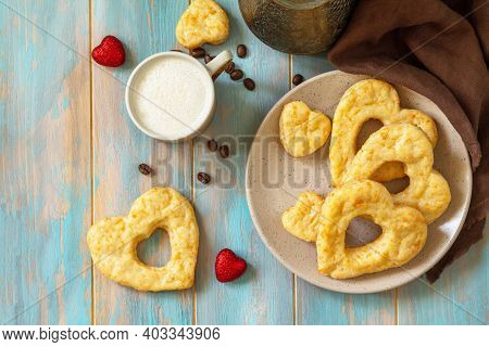 Breakfast For Valentine's Day Or Mother's Day Concept. Curd Cheese Pastries And A Cup Of Cappuccino