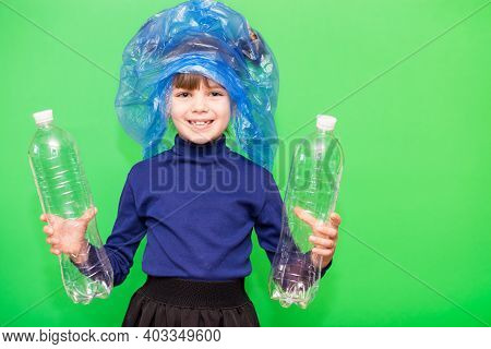 Girl Hold Trash Bag And Plastic Bottle And Shows Interest In Environmental Issues Isolated On Green
