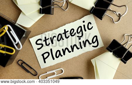 Strategic Planning, Text On Yellow Sticker On Table