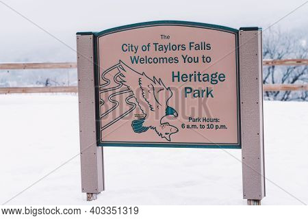 Taylors Falls, Minnesota - January 9, 2021: Sign For Heritage Park, Located Right Along The St. Croi