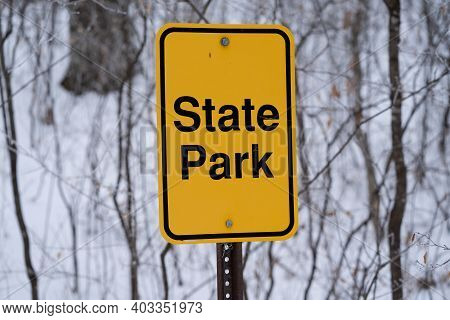 Sign For A State Park, In Yellow. Taken In Winter