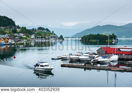 Cloudy summer view of Hardangerfjord and Norheimsund village, Norway, Europe. Landscape photography