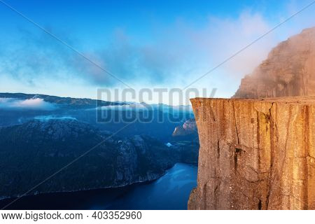 Misty morning on Preikestolen (pulpit-rock) - famous tourist attraction in the municipality of Forsand in Rogaland county, Norway. Landscape photography
