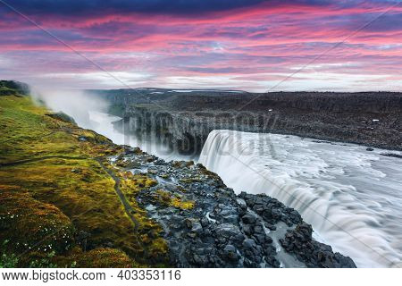 Colorful sunrise on Dettifoss - most powerful waterfall in Europe. Jokulsargljufur National Park, Iceland. Landscape photography