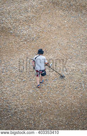 Brighton, East Sussex, Uk, June 2019 - A Man Using A Metal Detector On Brighton Beach, East Sussex,