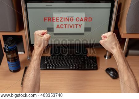 Fists Of Worried Angry Man Paying Online On Computer And Having Problem With Credit Card, Online Ban