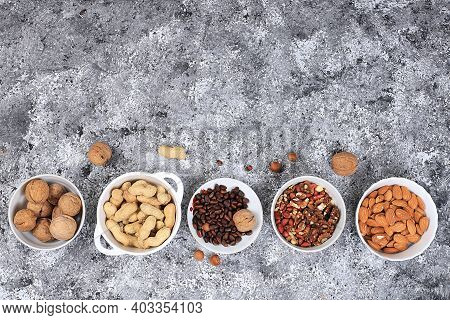 Assortment Of Different Nuts, The Concept Of Healthy Natural Food, Almonds, Pecans, Pistachios, Cash