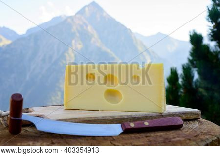 Cheese Collection, French Emmental De Savoie Cheese With Round Holes Served Outdoor In Savoy Region,
