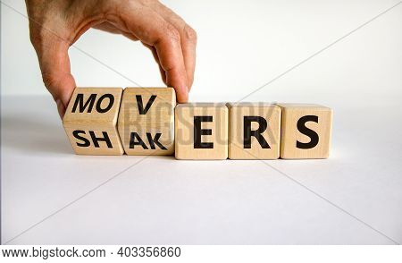 Movers And Shakers Symbol. Businessman Hand Turns Cubes And Changes The Word 'shakers' To 'movers'.