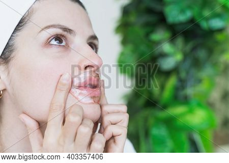 Beautiful Young Woman Uses Collagen Hydrogel Pink Lip Patch, Gel Mask For Smooth, Moisture Plumped S