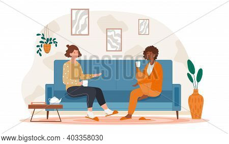 Two Female Friends Drinking Tea At Home. Concept Of Happy Friendship With Laughing And Gossiping. Fr