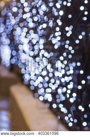Blurry Christmas Lights. Beautiful Bokeh. Christmas And New Year. Background For A Greeting Card Or