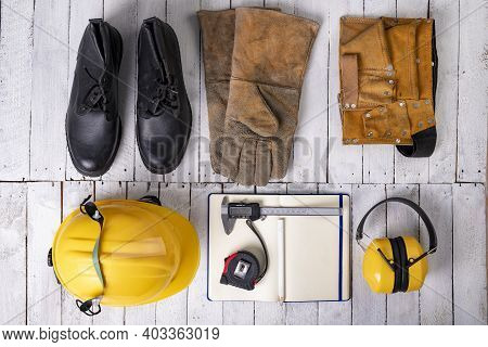 Workwear For A Production Worker On A White Table. Personal Protective Accessories Used At Work. Lig