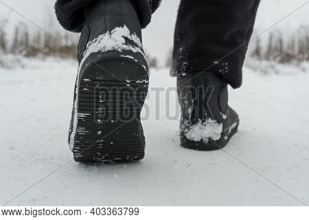 A Man Walks In The Snow In Boots, The Sole Is Close-up.