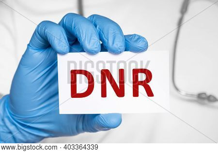 Doctor Holding A Card With Text Dnr Do Not Resuscitate, Medical Concept