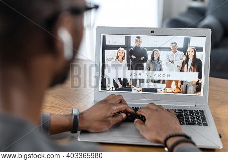 Unemployed Male Using Laptop, Browse Business Website. Focused African American Man Search A Job, Wr