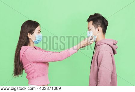 Young Couple Help Wearing  Protective Face Mask