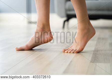 Underfloor Heat. Walking On Toes On Heated Floor