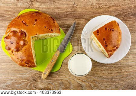 Section Of Pie With Cabbage And Egg On Green Cutting Board, Kitchen Knife, Glass Of Milk, Piece Of P