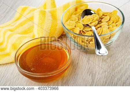 Striped Yellow Napkin, Transparent Bowls With Liquid Honey, Teaspoon In Bowl With Corn Flakes On Woo