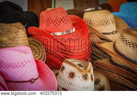 Colorful stack of hats up for sale in the market