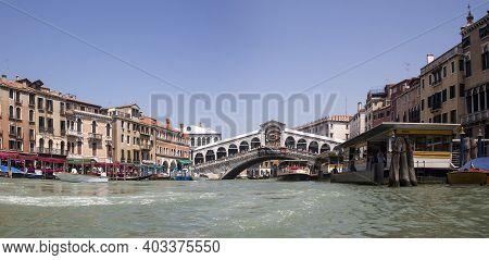 Venice, Italy - June 11, 2013: View Of The Rialto Bridge Over The Grand Canal In Venice