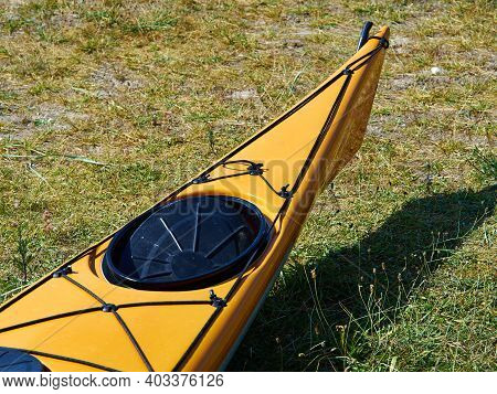 Bright Yellow Sea Kayak On The Beach Ready For Action Sports Activity