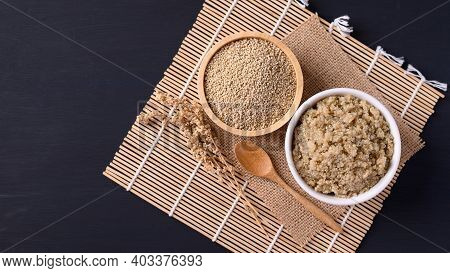 Cooked Brown Quinoa Seeds And Raw Quinoa Seeds In A Bowl With Spoon, Top View, Healthy Vegan Food