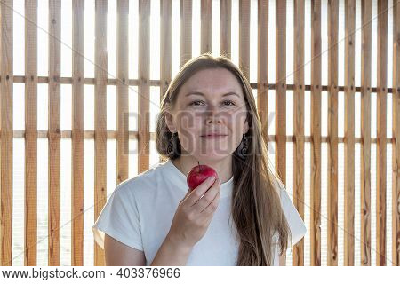 Authentic Portrait Of Modern 40 Year Old Woman With Straight Long Hair And Enigmatic Look. Natural A