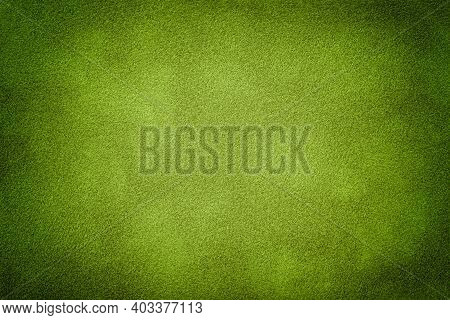 Dark Green Matte Background Of Suede Fabric With Vignette, Closeup. Velvet Texture Of Seamless Olive