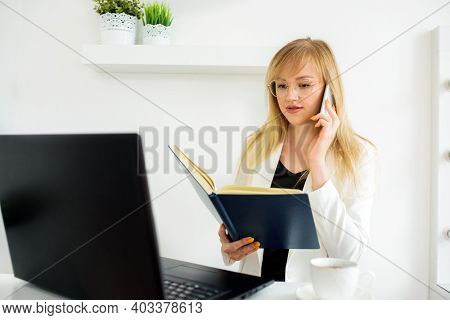 Female Lawyer Giving A Consultation Online At Home.online Counseling, Online Education, Distance Lea