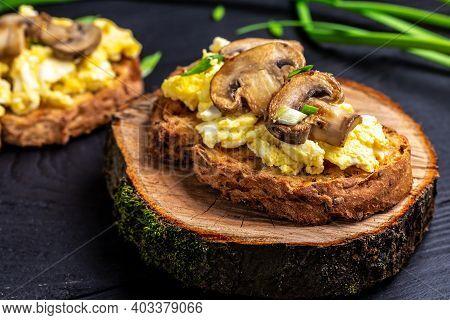 Scrambled Eggs And Mushrooms On Wholewheat Toast. Healthy Breakfast Or Brunch. Banner, Menu Recipe.