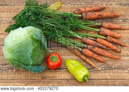 Just Picked Carrots, A Cabbage, Bell Peppers On The Wooden Boards. Just Harvested Fresh Vegetables.