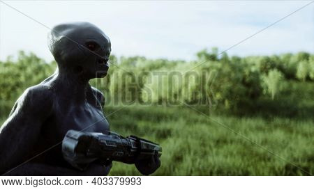 Military Alien With A Weapon Walks Through The Meadow Against The Background Of The City. 3d Renderi