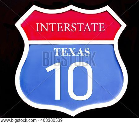 Interstate Red Blue Road Sign Us State Texas 10 Close Up Isolated On Black Background. 3d Illustrati