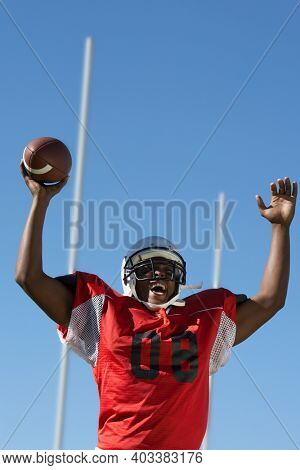Photo of african american Football Player Celebrating Touchdown