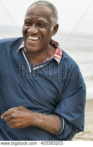 Portrait of african american senior man at the beach