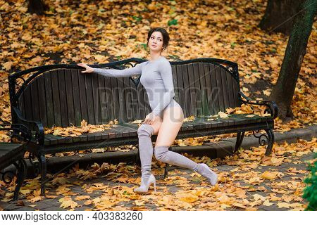 Beautiful Young Woman In Lingerie In Autumn Forest